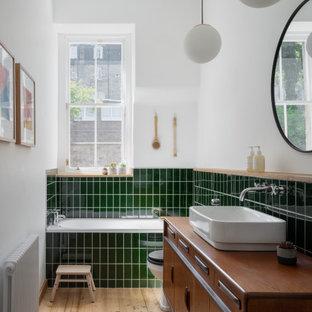 Medium sized scandinavian family bathroom in Edinburgh with freestanding cabinets, medium wood cabinets, green tiles, porcelain tiles, white walls, a vessel sink, wooden worktops, beige floors, brown worktops and a freestanding vanity unit.