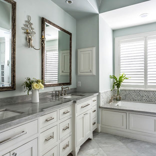 Elegant master metal tile gray floor bathroom photo in Houston with beaded inset cabinets, white cabinets, an undermount tub, blue walls and an undermount sink