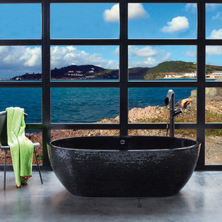 Example of a coastal mosaic tile freestanding bathtub design in Miami