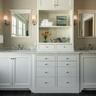 Bathroom - mid-sized traditional slate floor and gray floor bathroom idea in Portland Maine with an undermount sink, recessed-panel cabinets, white cabinets, marble countertops and gray walls