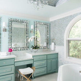Inspiration for a traditional ensuite bathroom in Houston with raised-panel cabinets, green cabinets, a freestanding bath, green tiles, multi-coloured tiles, white walls, a submerged sink, marble worktops and white floors.