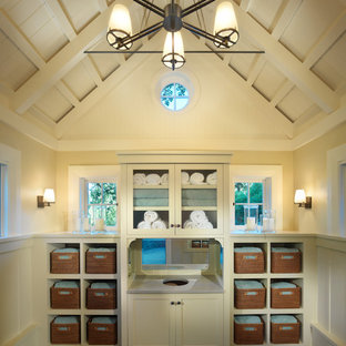 This is an example of a classic bathroom in San Francisco with open cabinets and beige cabinets.
