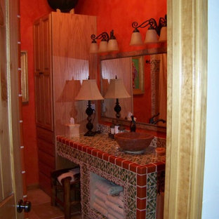 Storage closet remodeled to add a full bathroom, with talavera tile and other tr