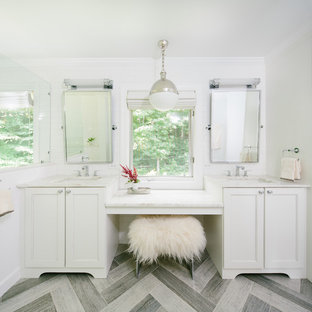Example of a transitional white tile and subway tile bathroom design in Other with recessed-panel cabinets, white cabinets and white walls