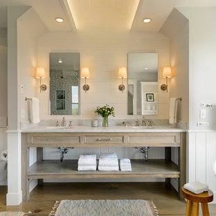 Country master bathroom in Burlington with an undermount sink, open cabinets, distressed cabinets, a freestanding tub, a wall-mount toilet and white walls.