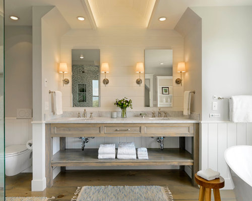 best farmhouse bathroom with distressed cabinets design ideas