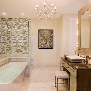 Trendy multicolored tile and matchstick tile freestanding bathtub photo in Austin with a vessel sink
