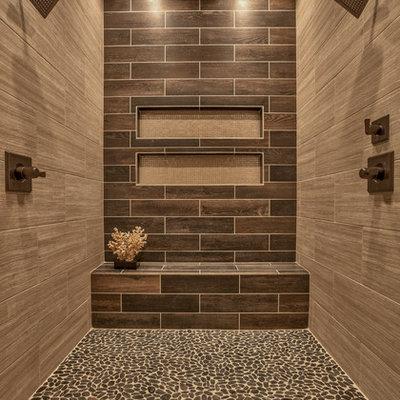 Double shower - transitional brown tile pebble tile floor double shower idea in Omaha
