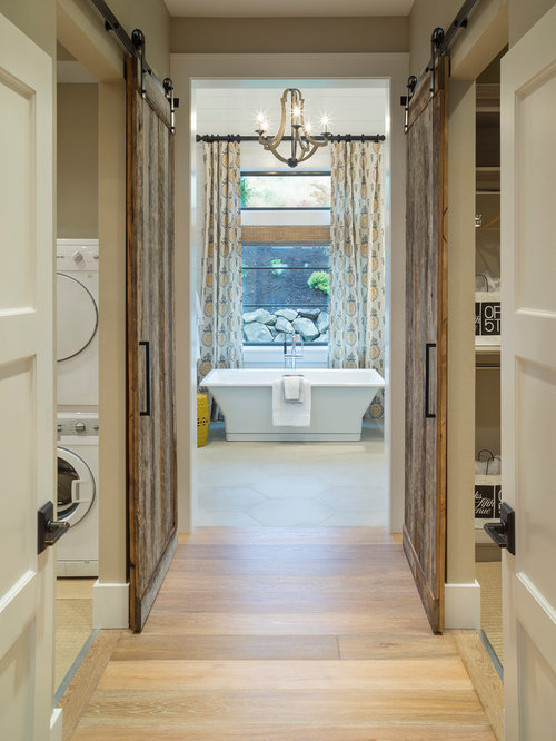 Example Of A Transitional Light Wood Floor Freestanding Bathtub Design In  Portland