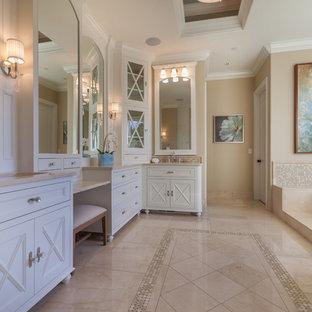 Свежая идея для дизайна: огромная главная ванная комната в классическом стиле с накладной ванной, фасадами с утопленной филенкой, белыми фасадами, бежевой плиткой, плиткой мозаикой, бежевыми стенами, полом из керамогранита, врезной раковиной, мраморной столешницей и бежевым полом - отличное фото интерьера