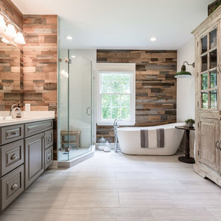 Inspiration for a rustic beige floor bathroom remodel in DC Metro with raised-panel cabinets, gray cabinets, white walls, an undermount sink, a hinged shower door and white countertops