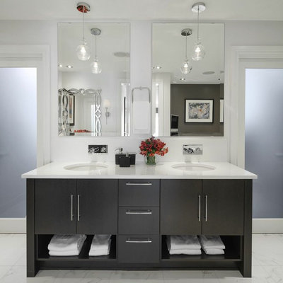 Example of a large trendy master white tile marble floor and white floor bathroom design in Ottawa with an undermount sink, flat-panel cabinets, dark wood cabinets, white walls and marble countertops