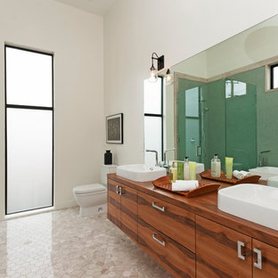 Bathroom - contemporary green tile bathroom idea in Los Angeles with a vessel sink, flat-panel cabinets, medium tone wood cabinets and white walls