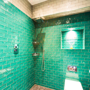 Contemporary bathroom in London with a walk-in shower, a one-piece toilet, green tiles and green walls.