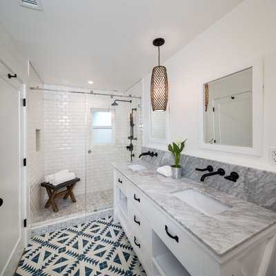 Inspiration for a mid-sized eclectic master white tile and ceramic tile light wood floor and green floor bathroom remodel in San Francisco with flat-panel cabinets, white cabinets, a one-piece toilet, white walls, an undermount sink and marble countertops