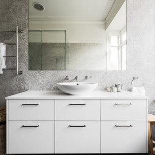 Design ideas for a mid-sized contemporary master bathroom in Melbourne with flat-panel cabinets, white cabinets, a claw-foot tub, a one-piece toilet, gray tile, ceramic tile, grey walls, a vessel sink and engineered quartz benchtops.