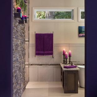 Ejemplo de cuarto de baño principal, clásico renovado, grande, con lavabo bajoencimera, armarios con paneles empotrados, puertas de armario de madera oscura, encimera de granito, bañera exenta, ducha a ras de suelo, sanitario de una pieza, baldosas y/o azulejos de porcelana y suelo de baldosas de porcelana