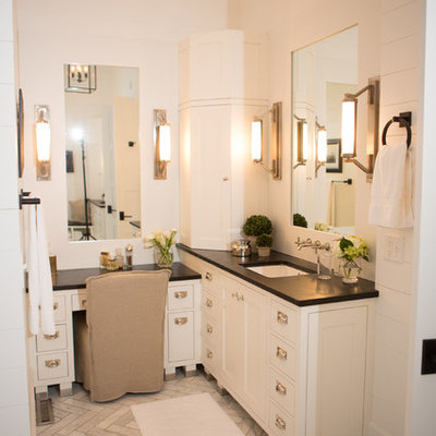 Farmhouse bathroom photo in Columbus with an undermount sink and soapstone countertops