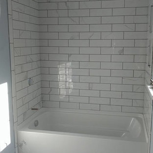 Example of a small classic 3/4 gray tile, white tile and subway tile linoleum floor bathroom design in Orange County with blue walls