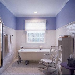 Idee per una stanza da bagno classica con vasca con piedi a zampa di leone e piastrelle diamantate