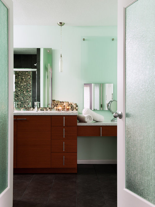 Example Of A Trendy Pebble Tile Bathroom Design In Kansas City With  Flat Panel Cabinets