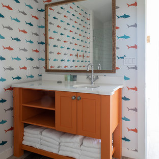 Inspiration for a mid-sized 1950s kids' ceramic floor and brown floor corner shower remodel in Other with recessed-panel cabinets, orange cabinets, white walls, an undermount sink, quartzite countertops, a hinged shower door and white countertops
