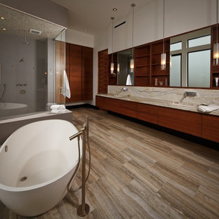 Bathroom - modern bathroom idea in Houston with an undermount sink, flat-panel cabinets, dark wood cabinets and marble countertops