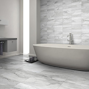 Inspiration for a mid-sized modern master bathroom in Toronto with flat-panel cabinets, grey cabinets, a freestanding tub, a one-piece toilet, gray tile, white tile, ceramic tile, grey walls, ceramic floors, a vessel sink and zinc benchtops.