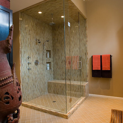 Example of a trendy matchstick tile and beige tile corner shower design in Chicago
