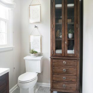 Alcove shower - small traditional master white tile and porcelain tile marble floor alcove shower idea in Other with furniture-like cabinets, dark wood cabinets, a one-piece toilet, a console sink, engineered quartz countertops and a hinged shower door