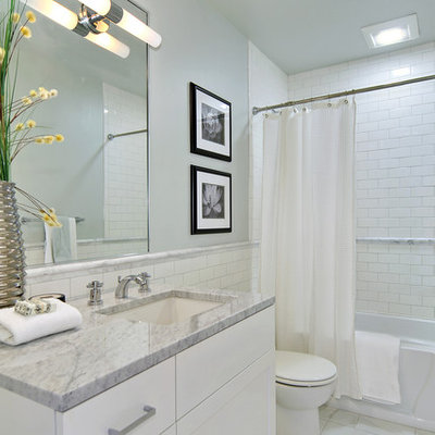 Elegant bathroom photo in Seattle with marble countertops