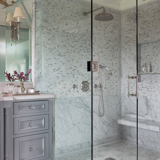 Example of a classic white tile and marble tile mosaic tile floor and multicolored floor corner shower design in Los Angeles with beaded inset cabinets, gray cabinets, white walls and a hinged shower door
