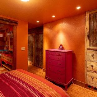 Imagen de cuarto de baño principal, de estilo americano, con armarios tipo mueble, puertas de armario naranjas, bañera con patas, ducha abierta, sanitario de una pieza, baldosas y/o azulejos naranja, baldosas y/o azulejos de terracota, parades naranjas, suelo de baldosas de terracota, lavabo sobreencimera, suelo naranja, ducha con cortina y encimeras naranjas