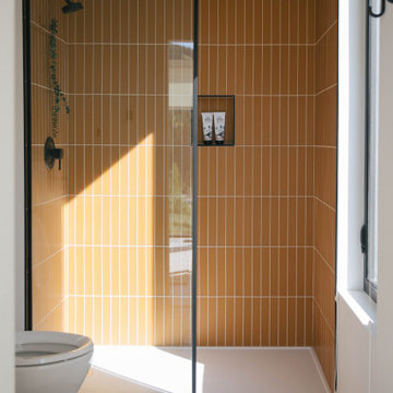 Sunny Walk-In Shower with Yellow Glass Tile