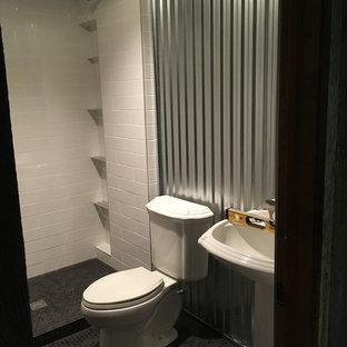 Esempio di una stanza da bagno con doccia minimalista di medie dimensioni con ante lisce, ante nere, doccia alcova, WC a due pezzi, pistrelle in bianco e nero, lastra di vetro, pareti gialle, pavimento in gres porcellanato e lavabo a colonna