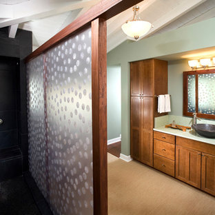 Inspiration for a coastal master black tile and slate tile beige floor bathroom remodel in Hawaii with beaded inset cabinets, medium tone wood cabinets, a one-piece toilet, recycled glass countertops, green countertops, green walls and a vessel sink