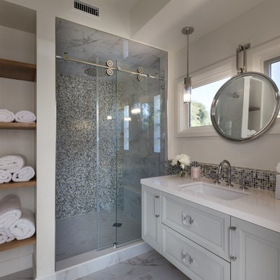 Inspiration for a mid-sized transitional 3/4 gray tile and mosaic tile white floor and marble floor bathroom remodel in Los Angeles with gray cabinets, white walls, an undermount sink, white countertops, raised-panel cabinets and quartz countertops