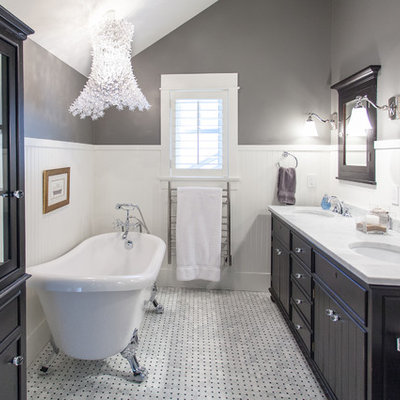 Bathroom - large traditional master white tile white floor and marble floor bathroom idea in Vancouver with an undermount sink, black cabinets, flat-panel cabinets, gray walls, marble countertops and white countertops