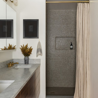 Bathroom - 1960s gray tile and mosaic tile brown floor bathroom idea in Seattle with flat-panel cabinets, medium tone wood cabinets, white walls, an undermount sink and gray countertops