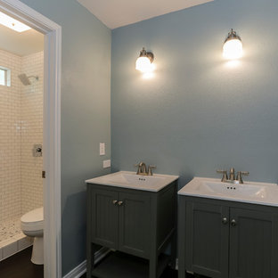 Example of a large classic master white tile and subway tile dark wood floor and brown floor alcove shower design in Houston with furniture-like cabinets, gray cabinets, gray walls, an integrated sink and quartzite countertops