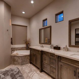 This is an example of a mediterranean bathroom in Phoenix with recessed-panel cabinets, orange cabinets, a built-in bath, porcelain tiles, porcelain flooring, a submerged sink, quartz worktops and a hinged door.
