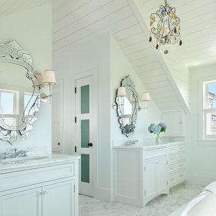 This is an example of a beach style bathroom in Boston with white cabinets.