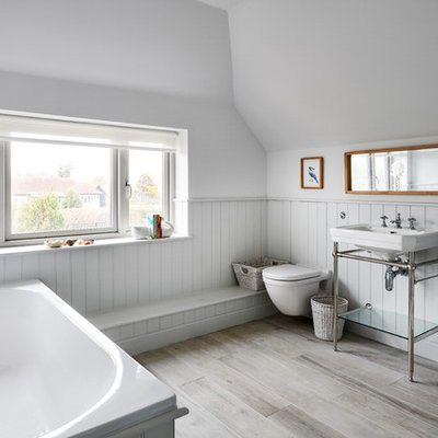 Drop-in bathtub - small coastal kids' beige floor drop-in bathtub idea in Hampshire with gray walls, a wall-mount toilet and a console sink