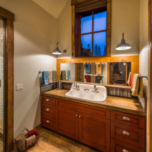 Alcove shower - rustic 3/4 alcove shower idea in Other with red cabinets and a hinged shower door