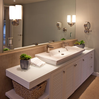 Bathroom - mid-sized contemporary master ceramic tile bathroom idea in San Diego with a trough sink, louvered cabinets, white cabinets, gray walls, solid surface countertops and white countertops