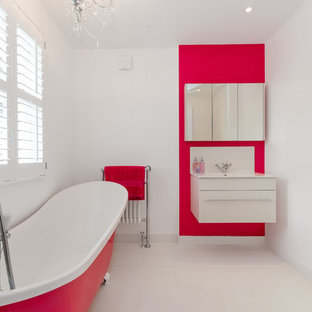 Medium sized contemporary ensuite bathroom in London with flat-panel cabinets, white cabinets, white walls, a wall-mounted sink, beige floors and a claw-foot bath.