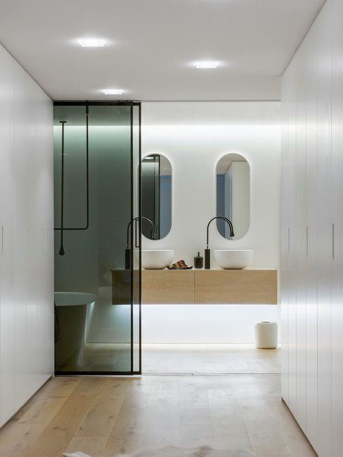 Ex&le of a mid-sized trendy master white tile light wood floor bathroom design in & Small Ensuite Bathroom Ideas | Houzz azcodes.com