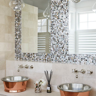 Inspiration for a transitional bathroom in Sydney with open cabinets, beige cabinets, multi-coloured walls and a vessel sink.