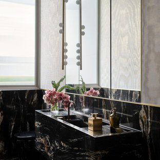 Large contemporary bathroom in Sydney with black tile, marble, marble benchtops and black benchtops.