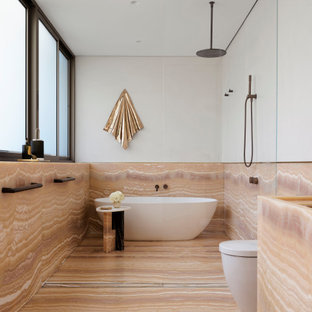 Photo of a large contemporary master bathroom in Sydney with onyx benchtops.